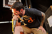 A Day To Remember performing on Warped Tour at Verizon Wireless Amphitheater in St. Louis, Missouri on August 3, 2011. © Todd Owyoung.