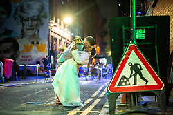 © Licensed to London News Pictures. 10/10/2020. Manchester, UK. A couple kiss in the road having just married at a registry office in Manchester City Centre . People out in pubs, bars and restaurants in Manchester City Centre ahead of the currently imposed daily 10pm curfew . Millions of people across the north of England are waiting to learn if the British Government will impose a regional lockdown on Monday (12th October 2020), as Coronovirus infection rates continue to rise rapidly . Photo credit: Joel Goodman/LNP