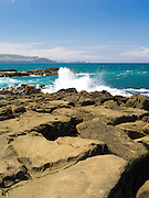 Surf crashing on the rocks at the mouth of Porpoise Bay, Catlins, Clutha, New Zealand.