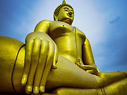 17 JULY 2017 - HUA TAPHON, ANG THONG, THAILAND: The big Buddha statue at Wat Muang in Ang Thong Province. The statue stands 92 m (300 ft) high, and is 63 m (210 ft) wide. Construction started in 1990, and completed in 2008. It is made of concrete and painted gold. It is the largest statue in Thailand and one of the largest statues in the world. The temple is renowned for the Buddha statue and its statue garden, which represents the Thai version of a hellish afterlife.     PHOTO BY JACK KURTZ