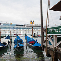VENICE, ITALY - MAY 06:  The new flagship of Costa Cruises Fascinosa sails in St Mark's Basin in front of a Gondola kiosk on its madien voyage on May 6, 2012 in Venice, Italy. Costa Cruise announced yesterday that new safety systems are installed to avoid tragedies like the one island of Giglio, which saw the Costa Concordia sink with the loss of 34 lives.  (Photo by Marco Secchi/Getty Images)