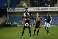 Ben Thompson of Millwall heads the ball over Kyel Reid of Bradford City. Skybet football league one play off semi final 2nd leg match, Millwall v Bradford city at The New Den in London on Friday 20th May 2016.<br /> pic by John Patrick Fletcher, Andrew Orchard sports photography.