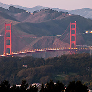 View of San Francisco's Golden Gate Bridge from Twin Peaks Summit at dusk with telephoto/zoom lens.
