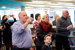 CARDIFF, ENGLAND - Tuesday, February 21, 2017: Members of the public watch as a flash mob choir in Cardiff Library sing the Champions League anthem The Prayer to promote the men's and women's UEFA Champions League Finals being staged in Cardiff this June. (Pic by Paul Greenwood/Propaganda)