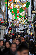© Licensed to London News Pictures. 09/12/2011, London, UK. Crowds Carnaby Street on Regent Street. Christmas shoppers in London's Oxford Street and Regent Street today 09 December 2011. Some of the shops are already having sales and displaying prices in windows. Photo credit : Stephen Simpson/LNP