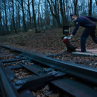 Boy changes the switch in front of the engine at the Children's Railway in a forest in the Buda Hills in Budapest, Hungary on November 15, 2014. ATTILA VOLGYI