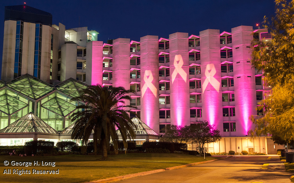 Pink ribbons representing breast cancer awareness are projected on the exterior of West Jefferson Medical Center by RZI Lighting, Inc.