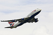 British Airways Jumbo Jet flying away from Heathrow, London, United Kingdom