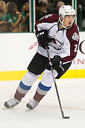 DALLAS, TX - SEPTEMBER 26:  Nick Holden #2 of the Colorado Avalanche controls the puck against the Dallas Stars in an NHL preseason game on September 26, 2013 at the American Airlines Center in Dallas, Texas.  (Photo by Cooper Neill/Getty Images) *** Local Caption *** Nick Holden