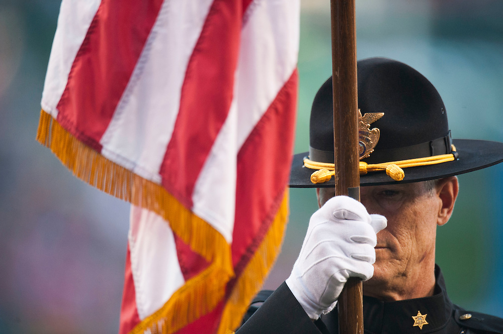 The Orange County Sheriff's Honor Guard stands at attention during the Angels' 7-4 loss to Oakland at Angel Stadium on Friday.<br /> <br /> ///ADDITIONAL INFO:   <br /> <br /> angels.0625.kjs  ---  Photo by KEVIN SULLIVAN / Orange County Register  --  6/24/16<br /> <br /> The Los Angeles Angels take on the Oakland Athletics Friday at Angel Stadium.<br /> <br /> <br />  6/24/16
