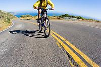 Young man biking Highway 1 near the California Coastal Trail; Golden Gate National Recreation Area. San Francisco,  CA