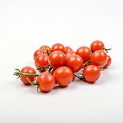 Fresh and organic cherry tomatoes on white background