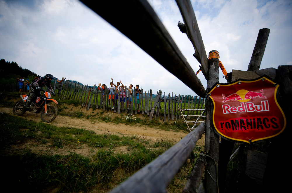 Children are cheering for a rider during the Red Bull Romaniacs hard enduro rally in Sibiu