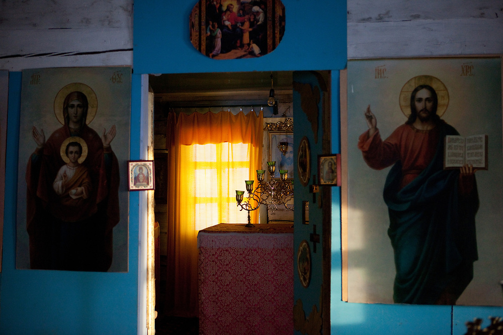 Inside of a Russian orthodox church and the museum of the political exile at the village of Cherkekh somewhere on the way in between the city of Yakutsk and Khandyga at the Kolyma highway in Yakutia. Yakutsk (Russian: Яку́тск) is a city in the Russian Far East, located about 4° (450 kilometres) south of the Arctic Circle. It is the capital of the Sakha (Yakutia) Republic in Russia with a major port on the Lena River. The city has a population of 264.000 (2009). Yakutsk is one of the coldest cities on Earth. The average monthly winter temperature in January is around −43,2 °C. Cherkekh, Jakutien, Yakutia, Russian Federation, Russia, RUS, 17.01.2010.