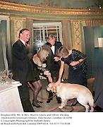 Stephen Hill, Mr. & Mrs. Martin Lewis and Oliver the dog. Duckworth Centenary Dinner. Dorchester, London 14/10/98<br /> © Copyright Photograph by Dafydd Jones<br /> 66 Stockwell Park Rd. London SW9 0DA<br /> Tel 0171 733 0108