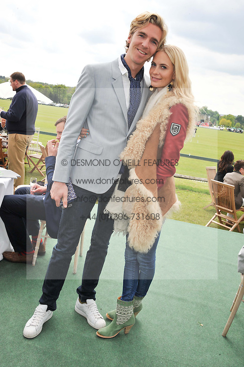 POPPY DELEVINGNE and JAMES COOK at the St.Regis International Polo Cup between England and South America held at Cowdray Park, West Sussex on 18th May 2013.  South America won by 11 goals to 9 goals.