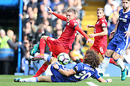 David Luiz of Chelsea slides in and tackles Jamie Vardy of Leicester City. Premier league match, Chelsea v Leicester city at Stamford Bridge in London on Saturday 15th October 2016.<br /> pic by John Patrick Fletcher, Andrew Orchard sports photography.