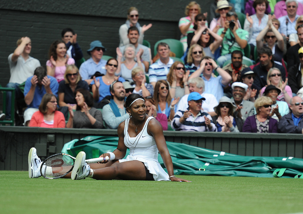 Serena Williams (USA)[7] iwatches her lob shot beat  Aravane Rezai (FRA) in todays first round match - Serena Williams (USA)[7] def Aravane Rezai (FRA) 6-3 3-6 6-1..Tennis - Wimbledon Lawn Tennis Championships - Day 2 Tue 21 Jun 2011 -  All England Lawn Tennis and Croquet Club - Wimbledon - London - England...