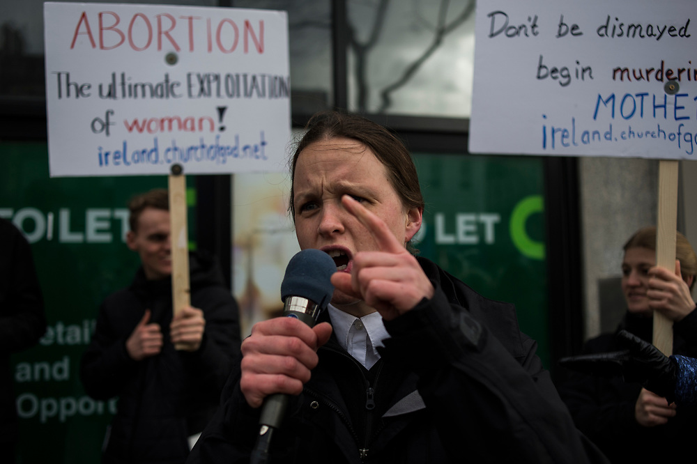 A member of Ireland's Church of God, preaches anti-abortion words to pro-life supporters taking part on a rally throughout Dublin City centre, on March 10, 2018.