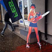 Chainsaw with high heels. #prag #praha #prag #hornipocernice #advertisement #commercial #street #shop #woman #rain #public #street #werbung #woman #highheels #chainsaw