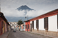 Classic view of World Heritage Antigua with wonderful old architecture, cobblestone streets and volcano looming in the background.