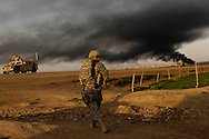 U.S. Army Sgt. Sean Bundy and Sgt. Dennis First walk to the rally point to link up with the Iraqi Army soldiers from the 4th Division 2nd Brigade 1st Battalion for an Iraqi Army led Operation Aerodrome of the Al Muradia village Iraq, Mar., 12, 2007. Bundy and First are assigned to 4th Platoon, Delta Company, 2nd Battalion, 27th Infantry Regiment, 3rd Brigade Combat Team, 25th Infantry Division, Schofield Barracks, Hawaii. Operation Aerodrome is a search of the village and near by airfield for high target items. .
