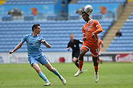Shrewsbury Town striker (on loan from Stoke City) Tyrese Campbell (11) heads the ball under pressure from Coventry City defender Dominic Hyam (15) during the EFL Sky Bet League 1 match between Coventry City and Shrewsbury Town at the Ricoh Arena, Coventry, England on 28 April 2019.