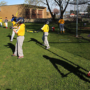 Young baseball players warming up during the Norwalk Little League baseball competition at Broad River Fields,  Norwalk, Connecticut. USA. Photo Tim Clayton