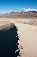 Footprints on ridge of Eureka dunes, Death Valley national park, California