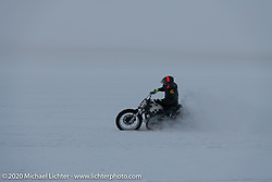 Mikhail Mikhin having a blast on Aleksei Kalabin's Kawasaki w650 in the snow during the Mikhail Mikhin riding Aleksei Kalabin's Kawasaki w650 racer in the snow during the Baikal Mile Ice Speed Festival. Maksimiha, Siberia, Russia. Saturday, February 29, 2020. Photography ©2020 Michael Lichter.