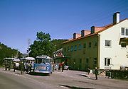 Local single decker buses to Kvanndal and Norheimsund, outside a cafe, Norway 1970