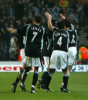 Photo. Andrew Unwin.<br /> Southampton v Newcastle United, FA Cup Third Round, Friends Provident St Marys Stadium, Southampton 03/01/2004.<br /> Newcastle's Laurent Robert (r) is mobbed by teammates after scoring the second goal of the game.