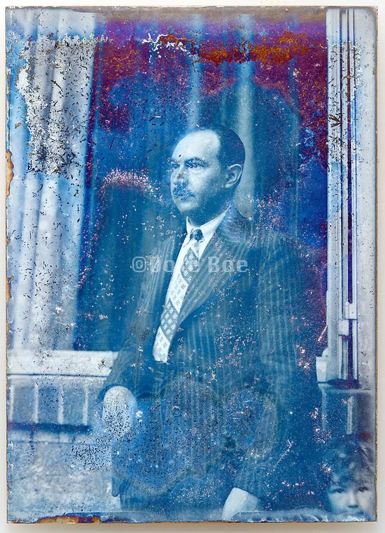 deteriorating portrait of man standing circa 1930s