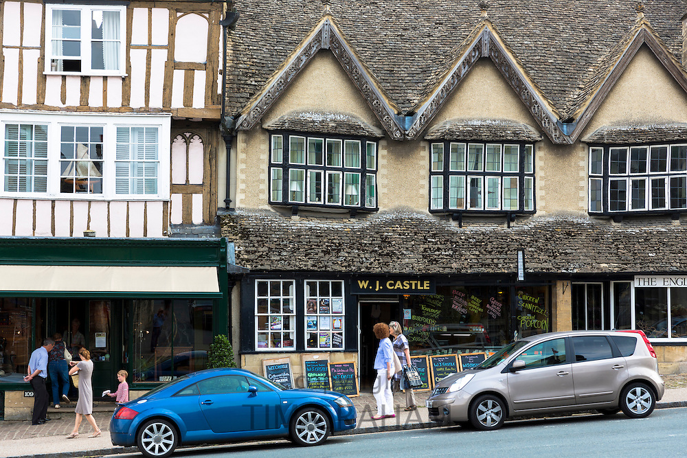 Quaint butcher and antique shop, medieval and Tudor architecture in famous Burford High Street, The Cotswolds, Oxfordshire, UK