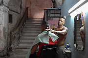 A barber at work in his Habana Vieja shop.