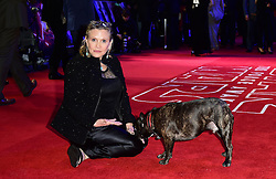 File photo dated 16/12/2015 of Carrie Fisher Carrie Fisher with her dog Gary as she arrives to the Star Wars: The Force Awakens European Premiere, as the actress has died at age 60, her daughter's publicist said.