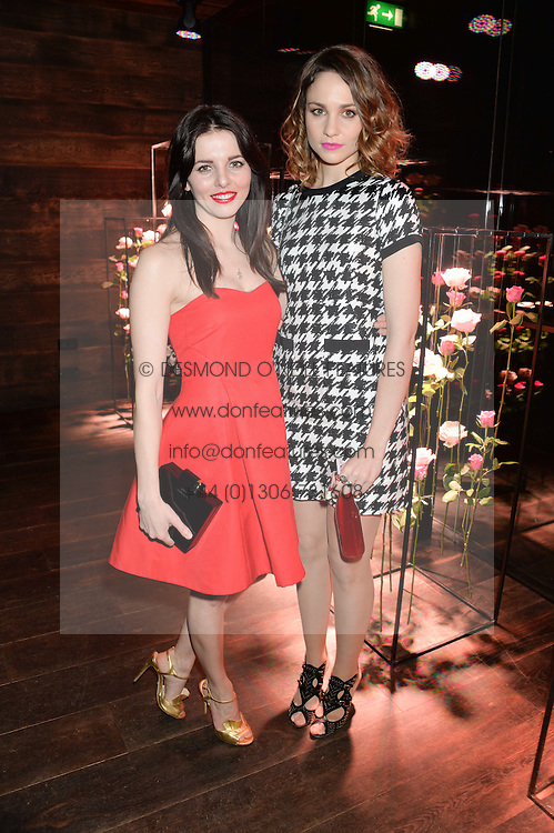Left to right, OPHELIA LOVIBOND and TUPPENCE MIDDLETON at the Lancôme pre BAFTA party held at The London Edition, 10 Berners Street, London on 14th February 2014.