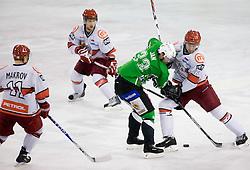 Ivo Jan of Olimpija vs Sabahudin Kovacevic of Acroni Jesenice at 38th Round of EBEL league  ice hockey match between HDD Tilia Olimpija Ljubljana and HK Acroni Jesenice, on January 1, 2010, in Arena Tivoli, Ljubljana, Slovenia. (Photo by Vid Ponikvar / Sportida)