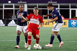 September 22, 2018 - Foxborough, MA, U.S. - FOXBOROUGH, MA - SEPTEMBER 22: Chicago Fire midfielder Bastian Schweinsteiger (31) steps in between New England Revolution midfielder Teal Bunbury (10) and New England Revolution midfielder Kelyn Rowe (11) during a match between the New England Revolution and the Chicago Fire on September 22, 2018, at Gillette Stadium in Foxborough, Massachusetts. The teams played to a 2-2 draw. (Photo by Fred Kfoury III/Icon Sportswire) (Credit Image: © Fred Kfoury Iii/Icon SMI via ZUMA Press)