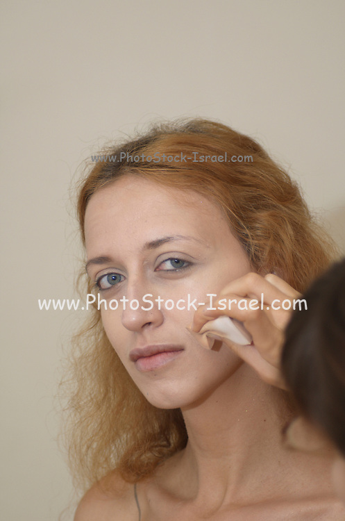 A blond Model with foundation and concealer,