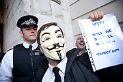 "Masked protesters at the Occupy London protest, October 15th 2011. Protest spreads from the US with this demonstrations in London and other cities worldwide. The 'Occupy' movement is spreading via social media. After four weeks of focus on the Wall Street protest, the campaign against the global banking industry started in the UK this weekend, with the biggest event aiming to ""occupy"" the London Stock Exchange. The protests have been organised on social media pages that between them have picked up more than 15,000 followers. Campaigners gathered outside  at midday before marching the short distance to Paternoster Square, home of the Stock Exchange and other banks.It is one of a series of events planned around the UK as part of a global day of action, with 800-plus protests promised so far worldwide.Paternoster Square is a private development, giving police more powers to not allow protesters or activists inside."