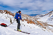 Backcountry skier on the North Lake road, Inyo National Forest, Sierra Nevada Mountains, California