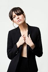 Woman Wearing Black Pant Suit