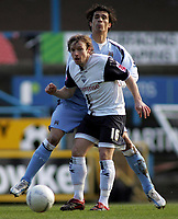 Photo: Paul Thomas.<br /> Preston North End v Manchester City. The FA Cup. 18/02/2007.<br /> <br /> Paul McKenna of Preston passes in the tackle of Bernardo Corradi.