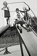 children posing on a slide Netherlands 1950s
