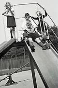 children posing on a slide Netherlands 1950s