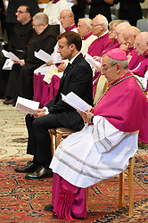 France's President Emmanuel Macron is inducted as honorary canon of The Basilica of St.John's (San Giovanni in Laterano) in Rome,Italy the Pope's cathedral in his capacity as bishop of the Italian capital on June 26, 2018. The french head of state has traditionally been given the title since French kings made large donations to support the cathedral in the 15th century. Photo by Eric Vandeville/ABACAPRESS.COM