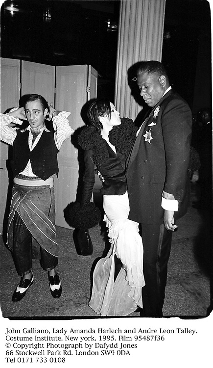 John Galliano, Lady Amanda Harlech and Andre Leon Talley. Costume Institute. New york. 1995. Film 95487f36<br /> © Copyright Photograph by Dafydd Jones<br /> 66 Stockwell Park Rd. London SW9 0DA<br /> Tel 0171 733 0108