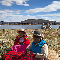 South America, Peru, Uros Islands. Uros women and embroidery of the floating reed islands of Lake Titicaca.