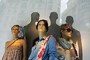 Reflections on Fashion. Traditional architecture reflected on a window at Zara store on Gran Via in Madrid, Spain.